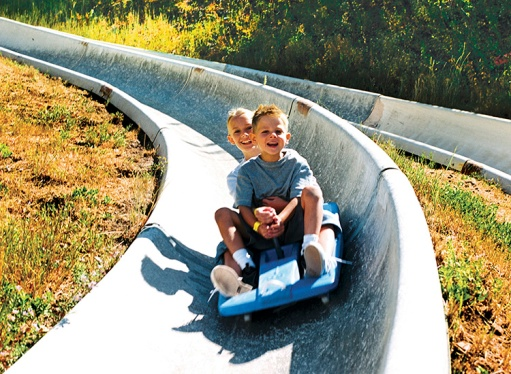 Children zip down the slipine slide every summer at Park City Mountain Resort.